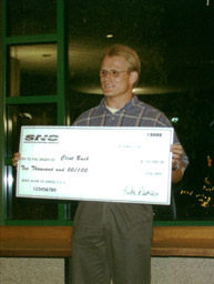 Clint accepting his check for $10,000!